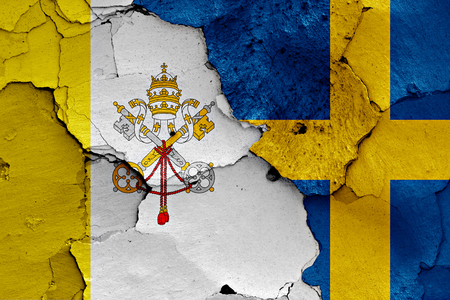 flag of Vatican and Sweden painted on cracked wall