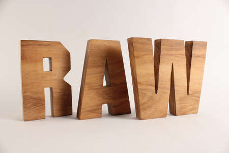 RAW text from wood letters Holz Buchstaben white Background