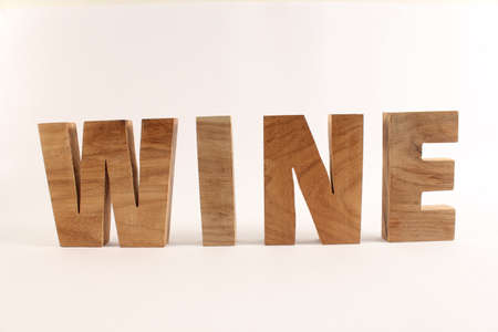 WINE text from wood letters Holz Buchstaben white Background straight