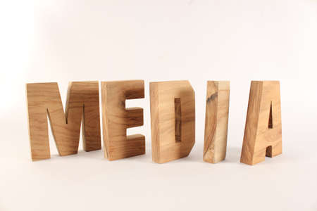 MEDIA text from wood letters Buchstaben white Background