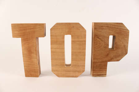 Top text from wood letters Holz Buchstaben white Background straight