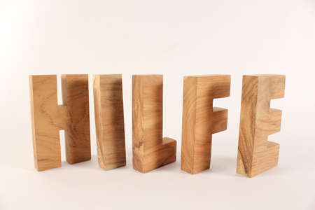 Hilfe text from wood letters Holz Buchstaben white Background