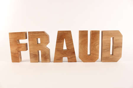 Fraud text from wood letters Holz Buchstaben white Background straight