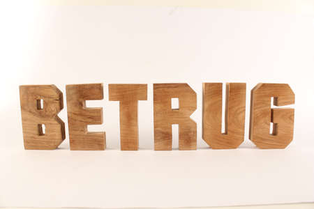Betrug text from wood letters Holz Buchstaben white Background straight