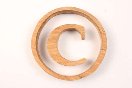Copyright text from wood letters Holz Buchstaben white Background