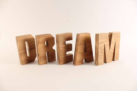 Dream text from wood letters Holz Buchstaben white Background