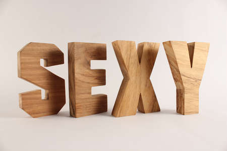 Sexy text from wood letters Holz Buchstaben white Background