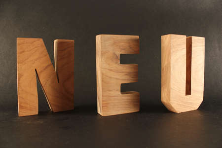 Neu text from wood letters Holz Buchstaben black Background