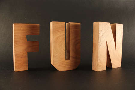 Fun text from wood letters Holz Buchstaben black Background