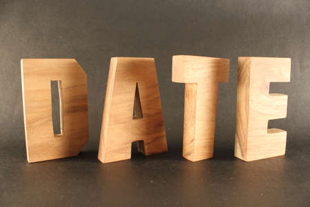 Date text from wood letters Holz Buchstaben black Background