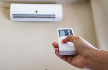 Closeup view about using some appliance such as air condition