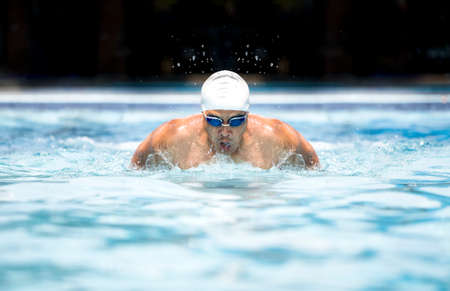 Photo pour Swimmer in cap and glasses in swimming pool - image libre de droit