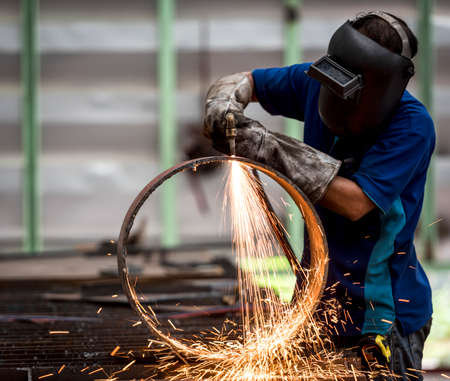 Photo for metal cutting with acetylene torch (Focus on Torch) - Royalty Free Image