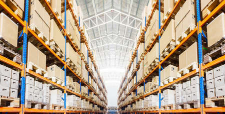 Photo pour Rows of shelves with boxes in modern warehouse - image libre de droit