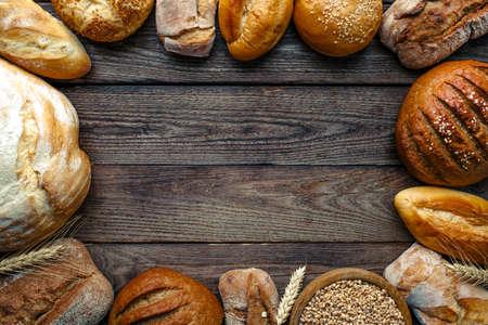 Foto für Assortment of baked bread on wooden table background,top view - Lizenzfreies Bild