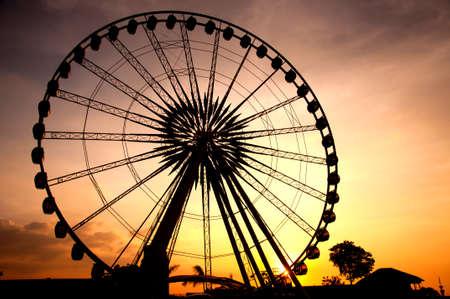 Silhouette of giant ferris wheel