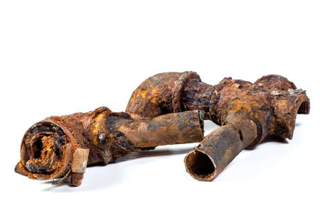 Photo pour Fragments of old cast-iron water pipes on white background. After many years of operation corroded metal pipe was destroyed. Rusty steel tube with holes of metallic corrosion. Rusty cast iron, metal - image libre de droit