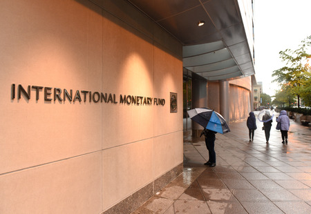 Washington, DC - June 04, 2018: People near the International Monetary Fund, IMF Headquarters 2 Building (HQ2) in DC.