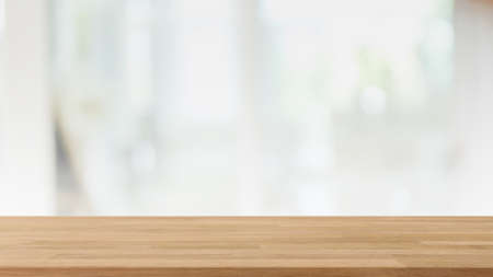 Empty wood table top and blur glass window interior restaurant and cafe banner mock up background - can used for display or montage your products.