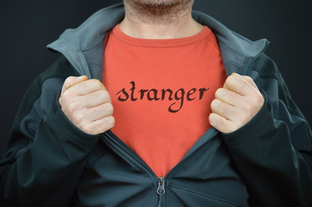 a man with the word stranger on his red t-shirt