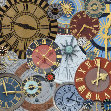 Photo for multicolored collection of ancient church tower clocks on a pile in different sizes and forms with roman numbers - Royalty Free Image