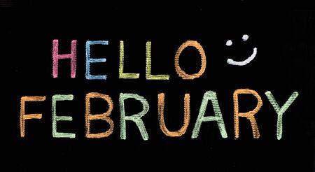 Photo pour Hello February written on blackboard - image libre de droit