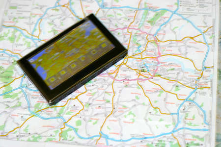 gps navigator on the map as background travel