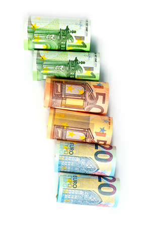a rolled paper euro banknotes as part of financial and trading systems in Europe