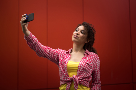 Young american woman taking selfie in New york, Time square