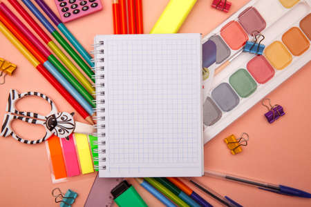Photo pour School notebook and various stationery on pink background. Back to school concept. - image libre de droit