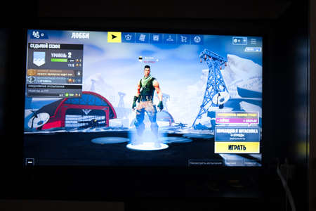 Photo pour Tula, Russia - JANUARY 27, 2019 - Fortnite video game screen with character and console controller. Fortnight Battle Royale online gaming by Epic - image libre de droit