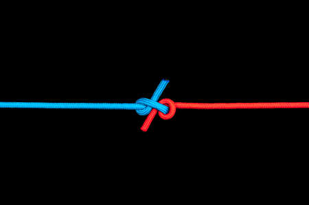 Knot on a cord on a dark background .