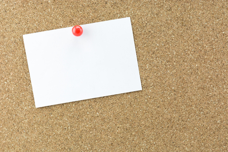 Photo for White reminder sticky note on cork board, empty space for text - Royalty Free Image