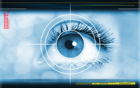 high-tech technology background with targeted eye on computer display の写真素材