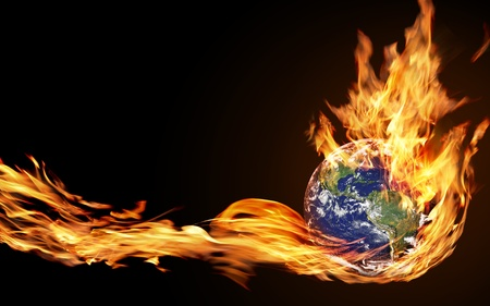 Foto de hand holds the fire of the globe - Imagen libre de derechos