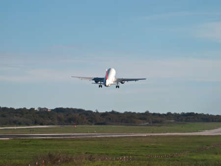 passenger airplane takeoff - back view