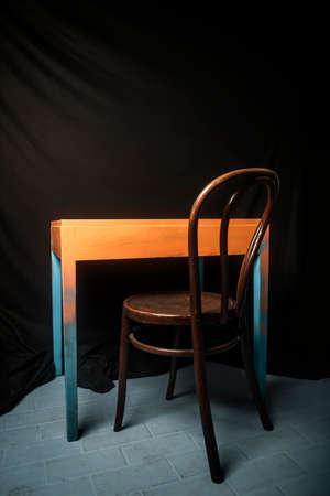 Photo pour Vintage chair and abstract table against dark background - image libre de droit