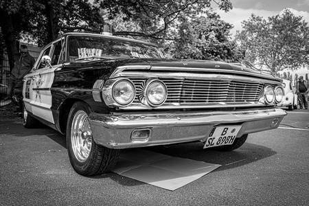 Photo for BERLIN - MAY 11, 2019: Police car Ford Galaxie 500 Interceptor, 1964. Black and white. 32th Berlin-Brandenburg Oldtimer Day. - Royalty Free Image