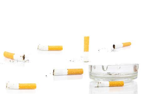 Photo pour cigarette butt in ashtray on white background, isolated - image libre de droit
