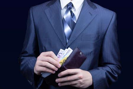 Foto de The man in the suit removes the money in the wallet, the businessman wallet Euro - Imagen libre de derechos