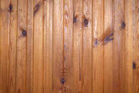 Photo pour grunge background: plank surface, varnished boards, yellow lights on top - image libre de droit