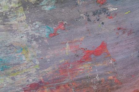 Foto de colorful creative motley background: smudged residues of oil paints on a wooden palette, short focus, selective blur - Imagen libre de derechos
