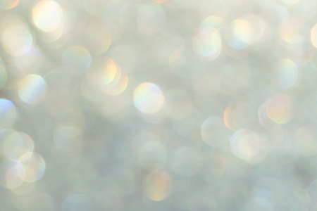 Photo pour bright glitter background: bokeh effect from many colored lights on frozen glass, toning - image libre de droit