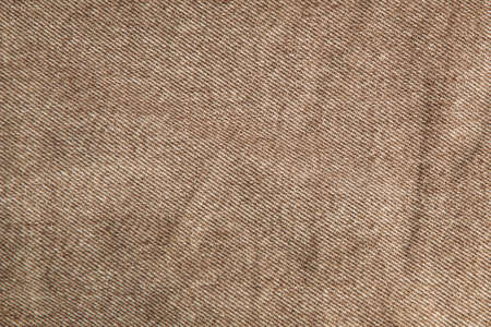 Photo pour fabric grunge background, real cotton denim brown, wrinkled, frayed, close - image libre de droit