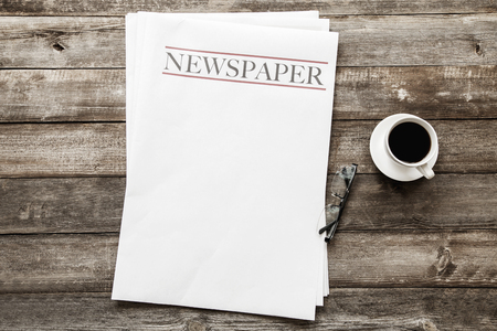 Photo for Newspaper and coffee on wooden background - Royalty Free Image