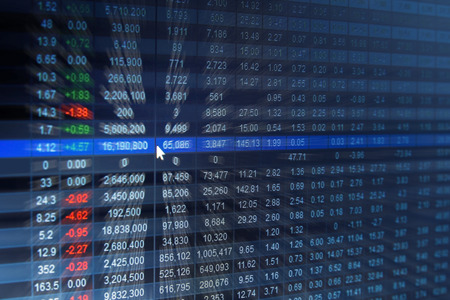 Financial data- stock exchange on the screen, blurred abstract background.