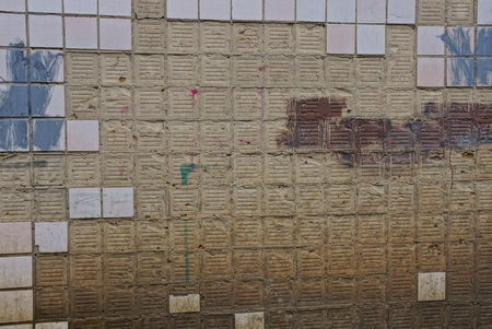Foto de gray brown texture from plaster on the wall and old square tile - Imagen libre de derechos