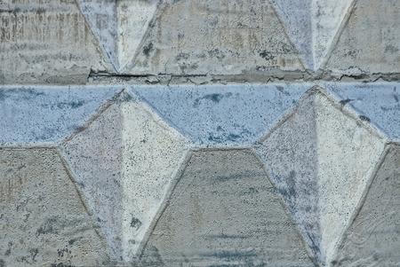 Foto de Gray stone texture of a concrete wall painted with silver paint - Imagen libre de derechos