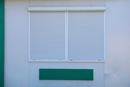 Photo pour roller shutters on a gray wall - image libre de droit