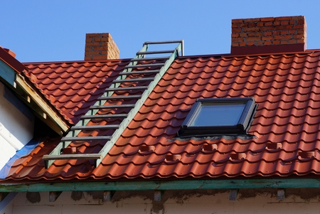 Photo for red tile roof with window stairs and chimney - Royalty Free Image